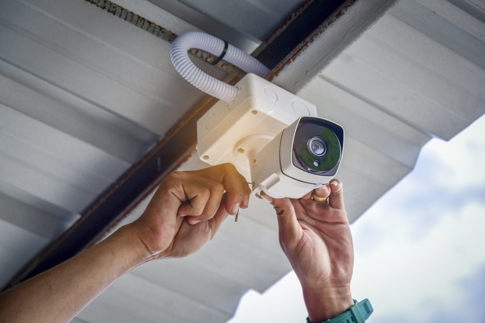 Technician Installing CCTV Camera System For Security Area